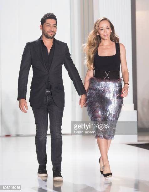 Michael Russo and Tamara Ralph walk the runway during the Ralph Russo Haute Couture Fall/Winter 20172018 show as part of Haute Couture Paris Fashion...