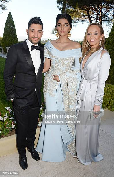 Michael Russo Sonam Kapoor and Tamara Ralph attend amfAR's 23rd Cinema Against AIDS Gala at Hotel du CapEdenRoc on May 19 2016 in Cap d'Antibes France