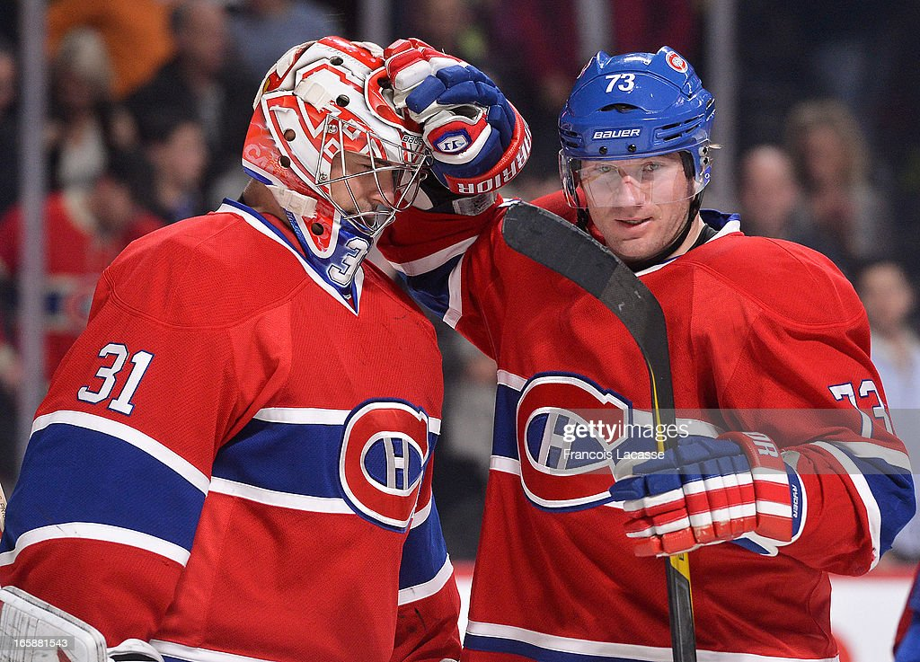 Michael Ryder #73 congratulates goaltender Carey Price #31of the Montreal Canadiens for the victory against the Boston Bruins after the NHL game on April 6, 2013 at the Bell Centre in Montreal, Quebec, Canada.