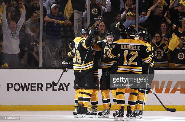 Michael Ryder of the Boston Bruins celebrates a second period goal with teammmates against the Tampa Bay Lightning in Game Two of the Eastern...