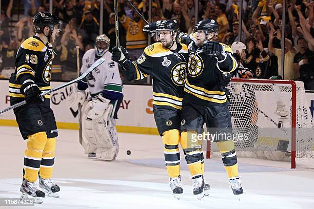Michael Ryder of the Boston Bruins celebrates with his teammates Chris Kelly and Tyler Seguin after scoring a goal in the second period against...