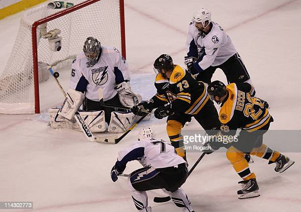 Michael Ryder of the Boston Bruins scores a second period goal past Dwayne Roloson of the Tampa Bay Lightning in Game Two of the Eastern Conference...