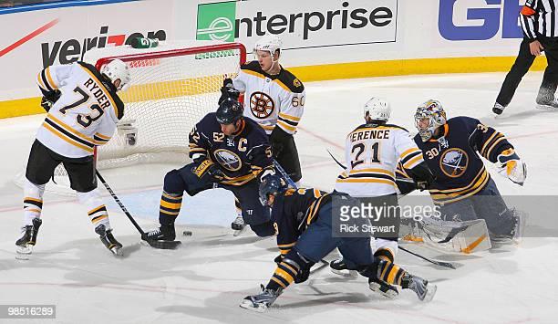 Michael Ryder of the Boston Bruins scores Boston's third goal against Craig Rivet Jason Pominville and Ryan Miller of the Buffalo Sabres as Vladimir...
