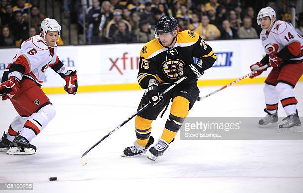 fc48cc3c8 Michael Ryder of the Boston Bruins watches the loose puck against the  Carolina Hurricanes at the