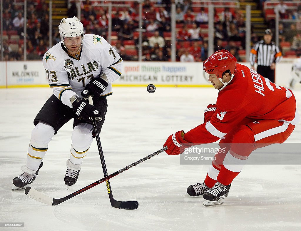 Michael Ryder #73 of the Dallas Stars battles for the puck with Kent Huskins #3 of the Detroit Red Wings during the second period at Joe Louis Arena on January 22, 2013 in Detroit, Michigan.