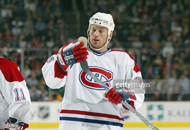 Michael Ryder of the Montreal Canadiens checks his stick blade during a break in game action against the Buffalo Sabres during their NHL preseason...