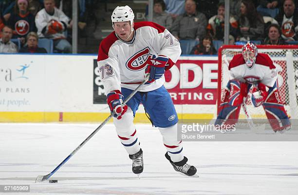 Michael Ryder of the Montreal Canadiens skates with the puck against the New York Islanders during their NHL game on February 28 2006 at the Nassau...