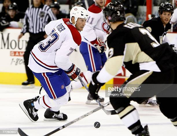 Michael Ryder of the Montreal Canadiens tries to skate around Mark Eaton of the Pittsburgh Penguins on October 10 2007 at Mellon Arena in Pittsburgh...