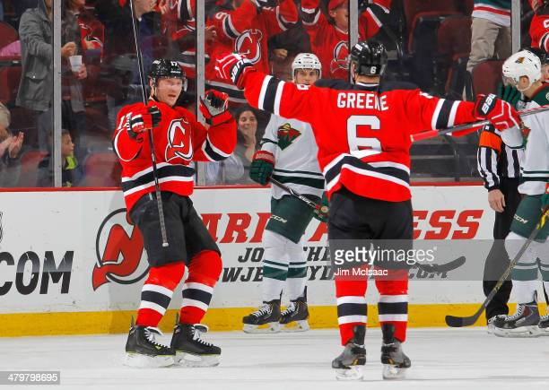 Michael Ryder of the New Jersey Devils celebrates his first period goal against the Minnesota Wild with teammate Andy Greene at the Prudential Center...