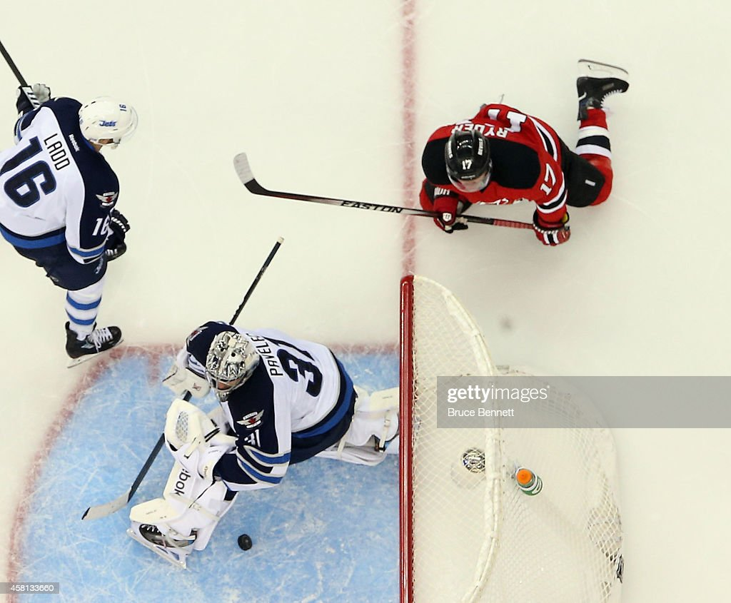 Michael Ryder #17 of the New Jersey Devils waches his third period shot get past Ondrej Pavelec #31 of the Winnipeg Jets to tie the game at the Prudential Center on October 30, 2014 in Newark, New Jersey. The Devils defeated the Jets 2-1 in the shootout.