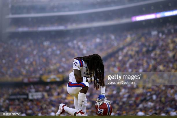 Michael Sam of the Louisiana Tech Bulldogs prays before a game against the LSU Tigers at Tiger Stadium on September 22 2018 in Baton Rouge Louisiana