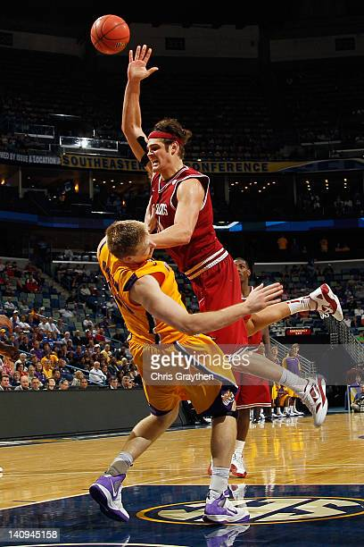 Michael Sanchez of the Arkansas Razorbacks shoots the ball over Justin Hamilton of the Louisiana State University Tigers during the first round of...