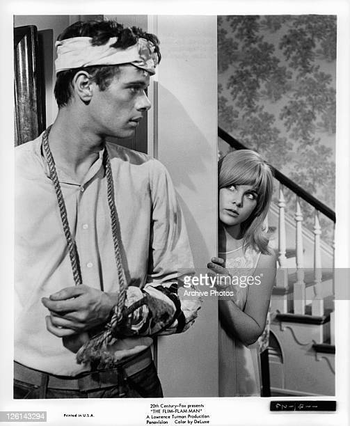 Michael Sarrazin And Sue Lyon meet for the first time in a scene from the film 'The Flim-Flam Man', 1967.