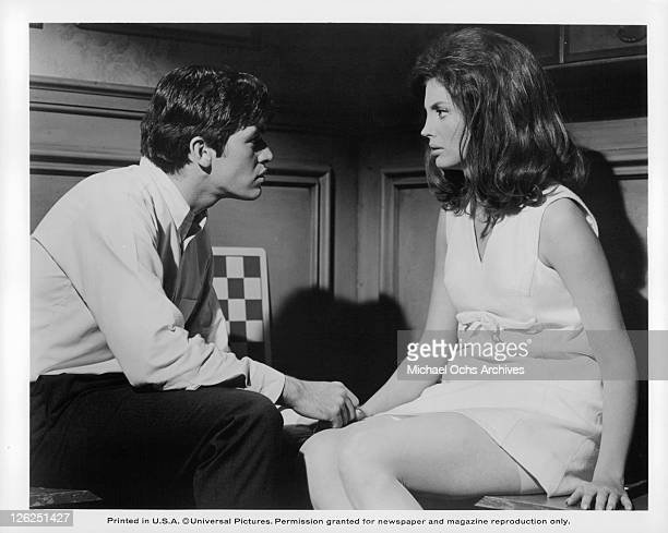 Michael Sarrazin sitting and holding Gayle Hunnicutt's hand in a scene from the film 'Eye Of The Cat' 1969