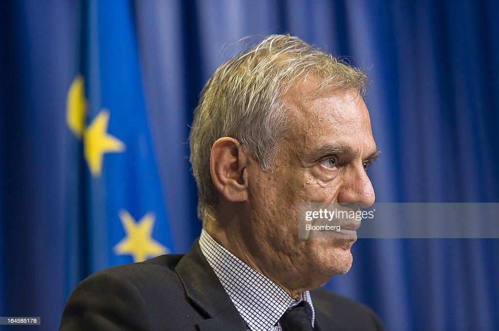 Michael Sarris, Cyprus's finance minister, attends a news conference following the Eurogroup meeting in Brussels, Belgium, on Monday, March 25, 2013. Cyprus dodged a disorderly default and unprecedented exit from the euro currency by bowing to demands to shrink its banking system in exchange for a 10 billion-euro ($13 billion) bailout. Photographer: Jock Fistick/Bloomberg via Getty Images