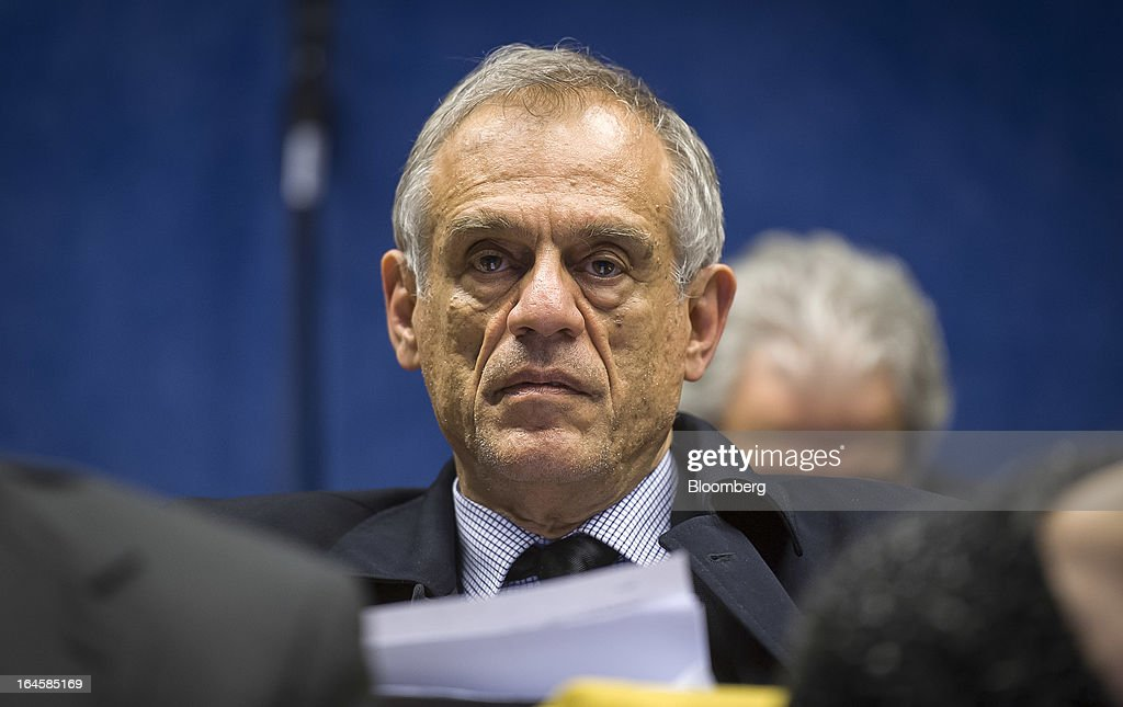 Michael Sarris, Cyprus's finance minister, listens during a news conference following the Eurogroup meeting in Brussels, Belgium, on Monday, March 25, 2013. Cyprus dodged a disorderly default and unprecedented exit from the euro currency by bowing to demands to shrink its banking system in exchange for a 10 billion-euro ($13 billion) bailout. Photographer: Jock Fistick/Bloomberg via Getty Images