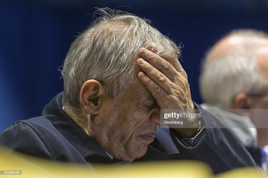 Michael Sarris, Cyprus's finance minister, reacts during a news conference following the Eurogroup meeting in Brussels, Belgium, on Monday, March 25, 2013. Cyprus dodged a disorderly default and unprecedented exit from the euro currency by bowing to demands to shrink its banking system in exchange for a 10 billion-euro ($13 billion) bailout. Photographer: Jock Fistick/Bloomberg via Getty Images