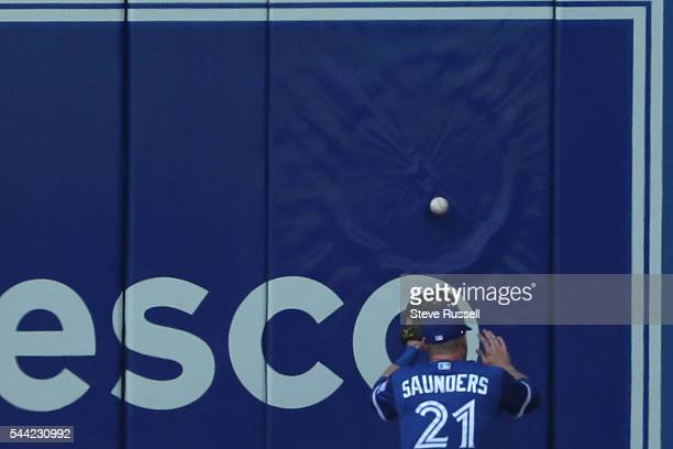 TORONTO ON JULY 2 Michael Saunders has a ball bounce off the wall as the Toronto Blue Jays beat the Cleveland Indians 96 to end their 14 game winning...