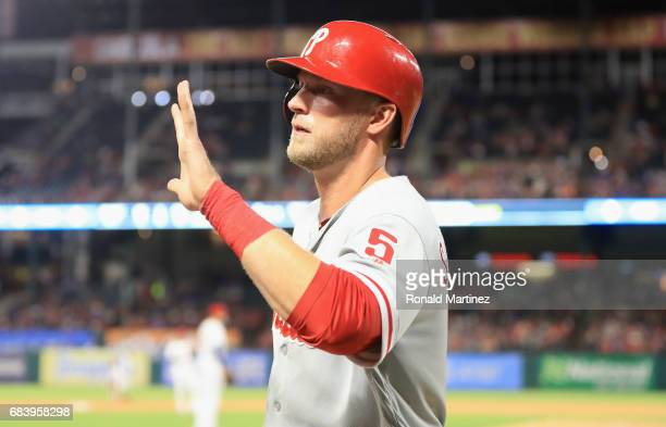 Michael Saunders of the Philadelphia Phillies celebrates after scoring in the seventh inning against the Texas Rangers at Globe Life Park in...