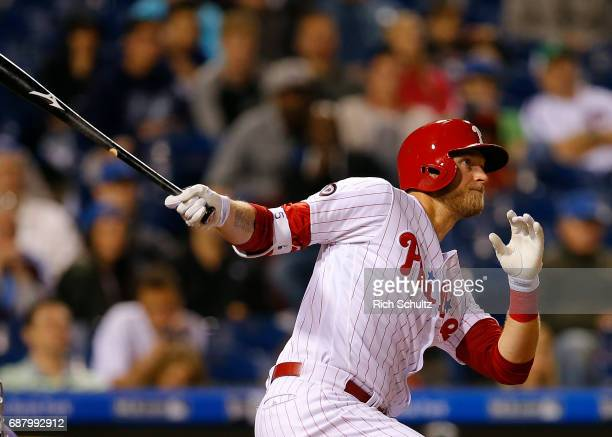 Michael Saunders of the Philadelphia Phillies hits a tworun home run in the eighth inning during a game against of the Colorado Rockies at Citizens...