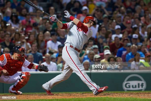 Michael Saunders of the Philadelphia Phillies swings at a pitch during the sixth inning against the Boston Red Sox at Fenway Park on June 13 2017 in...