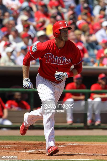 Michael Saunders of the Phillies hustles down to first base during the spring training game between the Pittsburgh Pirates and the Philadelphia...