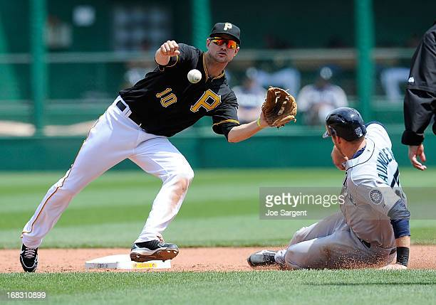 Michael Saunders of the Seattle Mariners safely steals second base in front of Jordy Mercer of the Pittsburgh Pirates during the sixth inning on May...