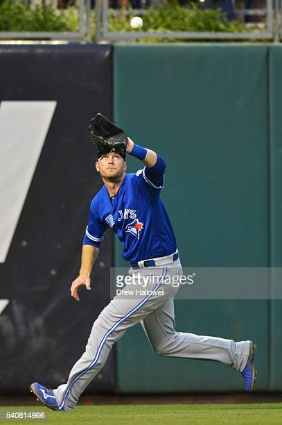 Michael Saunders of the Toronto Blue Jays catch a fly ball on the run in the third inning against the Philadelphia Phillies at Citizens Bank Park on...