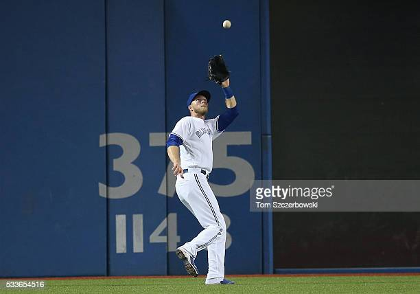 Michael Saunders of the Toronto Blue Jays catches a fly ball in the sixth inning during MLB game action against the Tampa Bay Rays on May 17 2016 at...