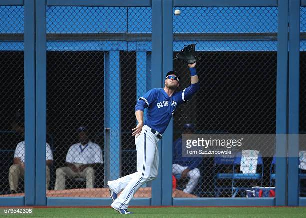 Michael Saunders of the Toronto Blue Jays catches a fly ball in the second inning during MLB game action against the Seattle Mariners on July 24 2016...