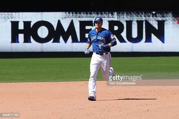 Michael Saunders of the Toronto Blue Jays circles the bases after hitting a solo home run in the eighth inning during MLB game action against the...