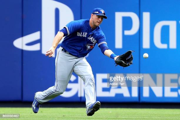 Michael Saunders of the Toronto Blue Jays grounds a ball in the first inning against the New York Yankees at Yankee Stadium on September 29 2017 in...