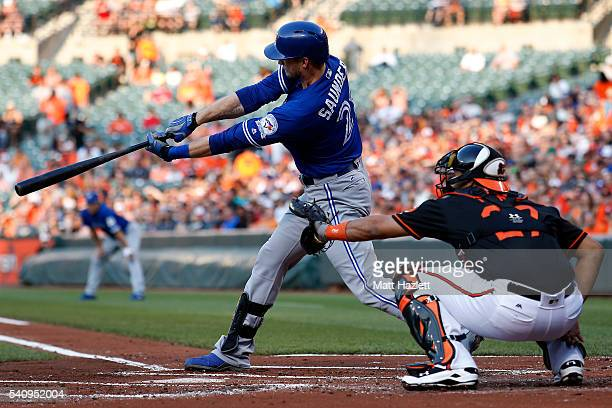 Michael Saunders of the Toronto Blue Jays hits a threerun home run in the first inning against the Baltimore Orioles at Oriole Park at Camden Yards...