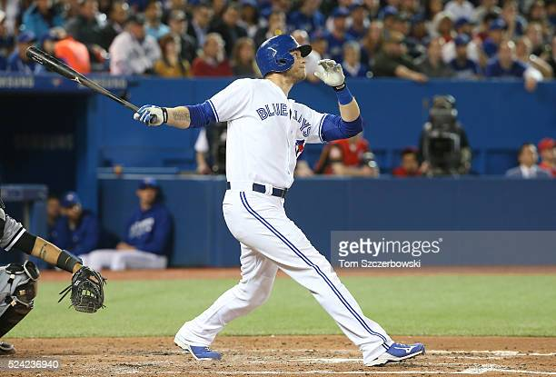 Michael Saunders of the Toronto Blue Jays hits a tworun home run in the third inning during MLB game action against the Chicago White Sox on April 25...