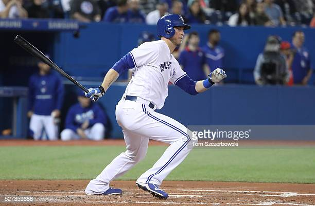 Michael Saunders of the Toronto Blue Jays hits an RBI single in the third inning during MLB game action against the Texas Rangers on May 2 2016 at...