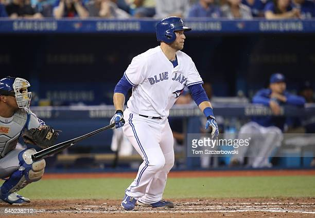 Michael Saunders of the Toronto Blue Jays hits an RBI single in the eighth inning during MLB game action against the Kansas City Royals on July 6...