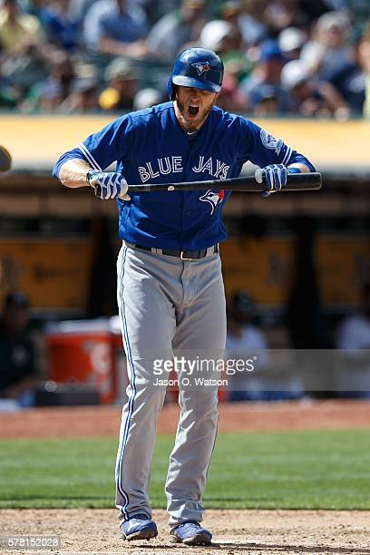 Michael Saunders of the Toronto Blue Jays reacts after striking out against the Oakland Athletics during the ninth inning at the Oakland Coliseum on...