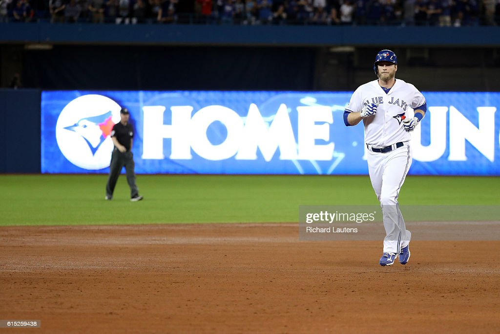 TORONTO, ON - OCTOBER, 17 - Michael Saunders #21 of the Toronto Blue Jays runs the bases after hitting a solo home run against the Cleveland Indians during the second inning in Game 3 of the ALCS baseball series at the Rogers Centre in Toronto, October 17, 2016.