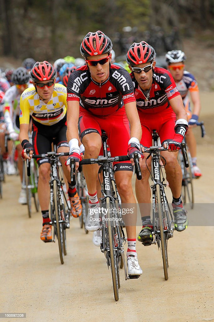 Michael Schar (C) of Switzerland and George Hincapie (R) riding for BMC Racing drives the peloton on the dirt road climb of Cottonwood Pass in an attempt to defend the overall race leader's yellow jersey for Tejay Van Garderen (L) during stage three of the USA Pro Challenge from Gunnison to Aspen on August 22, 2012 in Chaffee County, Colorado. Van Garderen lost the yellow jersey to Christian Vande Velde in the stage.