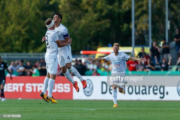 Michael Schindele of SSV Ulm and Florian Krebs of SSV Ulm celebrate after winning the DFB Cup first round match between SSV Ulm 1846 Fussball and...