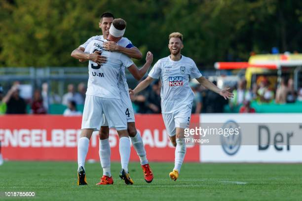 Michael Schindele of SSV Ulm, Florian Krebs of SSV Ulm and Johannes Reichert of SSV Ulm celebrate after winning the DFB Cup first round match between...