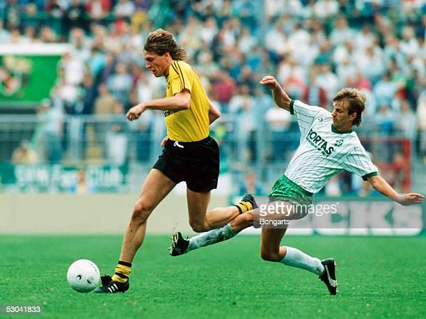 Michael Schulz of Borussia Dortmund challenges Manfred Bockenfeld of Werder Bremen during the 1bundesliga game between Werder Bremen and Borussia...