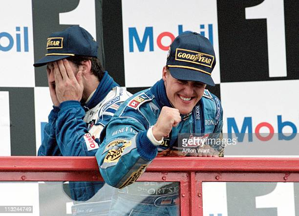 Michael Schumacher driver of the Benetton Formula Ltd Benetton B195 Renault 30 V10 pumps his fist and celebrates his victory at the French Grand Prix...
