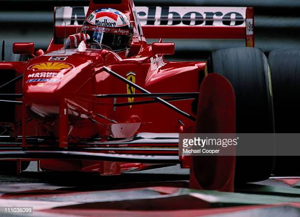 Michael Schumacher drives the Scuderia Ferrari Marlboro Ferrari F310B over the curbs during practice for the Belgian Grand Prix on 23rd August 1997...