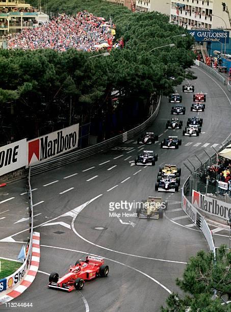 Michael Schumacher driving the Scuderia Ferrari Marlboro Ferrari F310B leads the field away at the startof the Grand Prix of Monaco on 11th May 1997...
