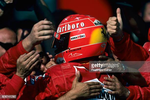 Michael Schumacher Ferrari F12000 Grand Prix of Italy Monza 10 September 2000 Michael Schumacher in the arms of his mechanics after winning the...
