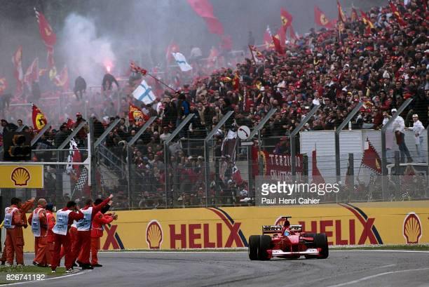 Michael Schumacher, Ferrari F1-2000, Grand Prix of San Marino, Imola, 09 April 2000. Victorious Michael Schumacher cheered by a crowd of loving...