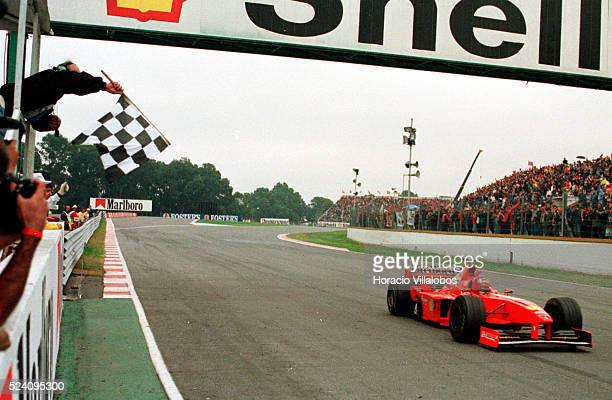 Michael Schumacher gets the checkered flag as he romps home in first position to win the 1998 Argentinian F1 Grand Prix