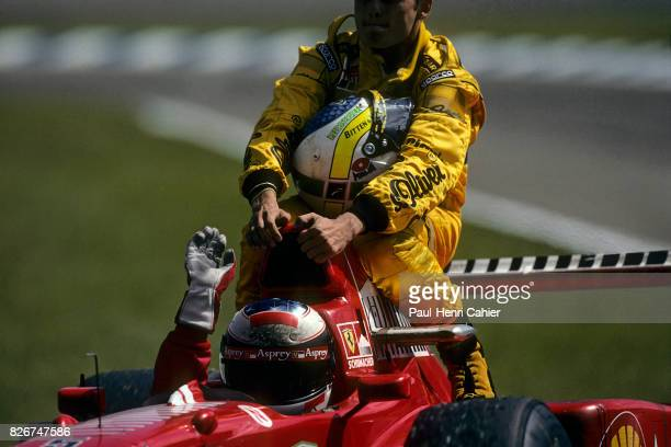 Michael Schumacher, Giancarlo Fisichella, Ferrari F310B, Grand Prix of Germany, Hockenheimring, 27 July 1997. Giancarlo Fisichella ridding piggyback...