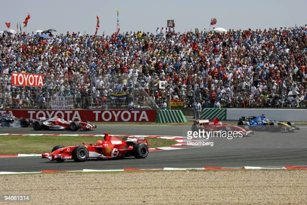 Michael Schumacher is seen leading the race at the Formula 1 GP in Magny Cours France Sunday July 16 2006 Ferrari's Michael Schumacher won Formula...